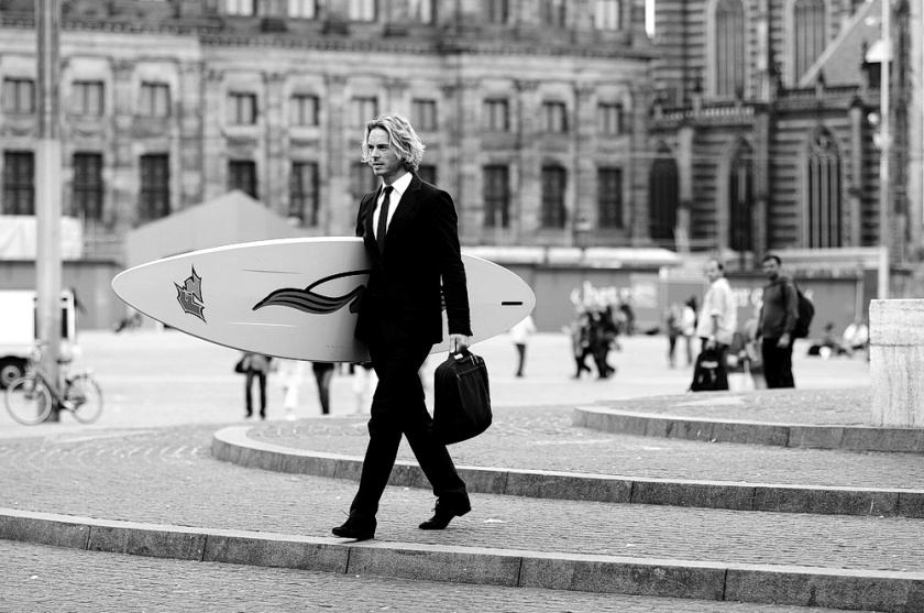 cool urban dude with surfboard
