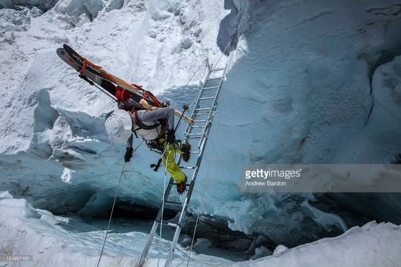 Hillary crosses bridges through the Khumbu ice fall.